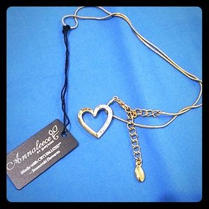 Gold Necklace with heart pendant.